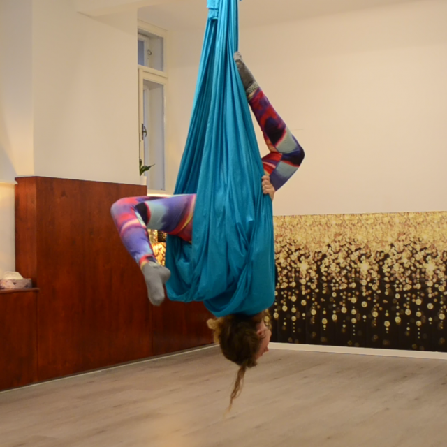 Hanging upside down on an aerial hammock